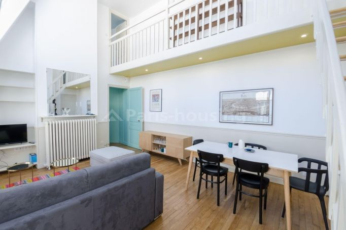 This beautiful and original top floor two bedroom furnished duplex artist workshop is located in the 7th arrondissement